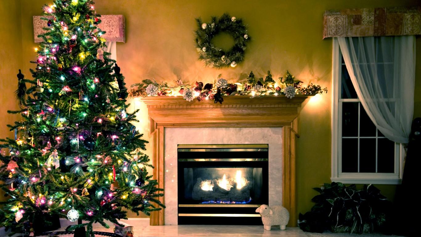 Christmas fireplace scene 1366x768 wallpaper for Wallpaper next home