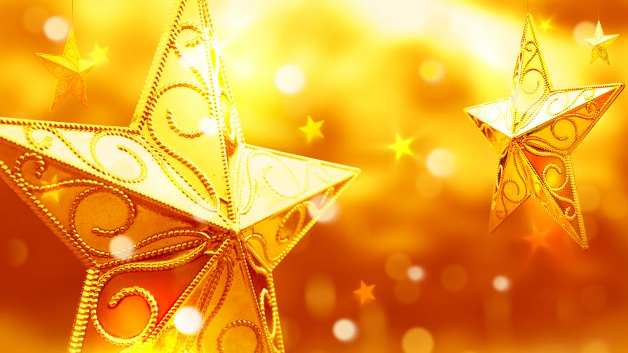Yellow christmas star ornaments wallpaper